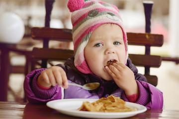 eating  toddler girl