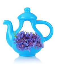 Beautiful bouquet of cornflowers in vase-teapot, isolated