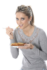 Model Released. Young Woman Eating Fish and Chips