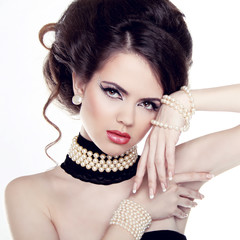 Jewelry and Hairstyle. Fashion portrait of beautiful woman with