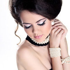 Closeup portrait of Beautiful woman with pearls and evening make
