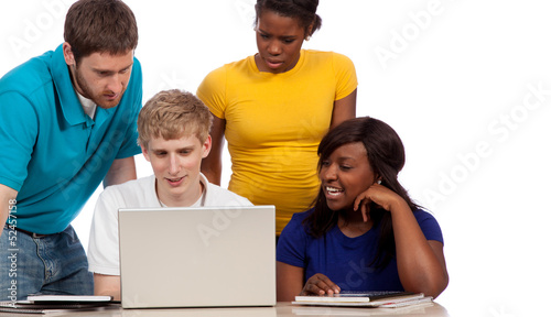 Diverse group of college students/friends looking at a computer