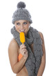 Model Released. Young Woman Eating Ice Lolly