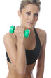 Model Released. Young Woman Exercising with Dumbbell Weights