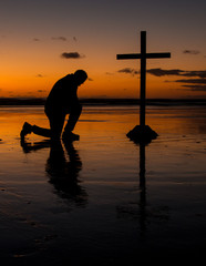 Kneeling Before The Cross