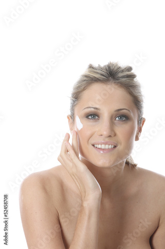 Model Released. Young Woman Applying Cream