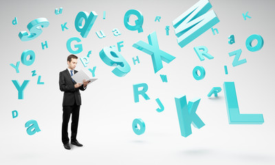 man holding book with many letters