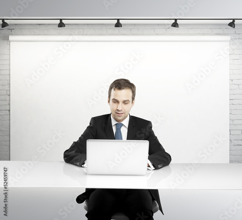 man with laptop in studio