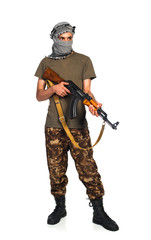 Terrorist with automatic gun on white background