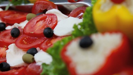 mozzarella salad with tomatoes and peppers with rice and olives
