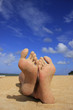 Sandy feet on a tropical beach