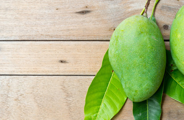 Mango on wood background