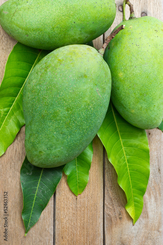 Fresh green mango on wood background