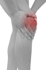 Acute pain in a woman  knee. Female holding hand to spot of knee