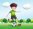 A boy with a green t-shirt playing football