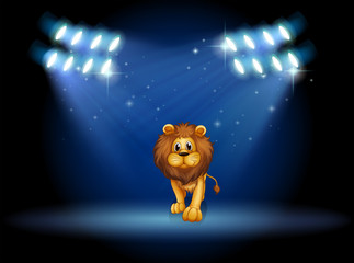 A lion at the center of the stage with spotlights