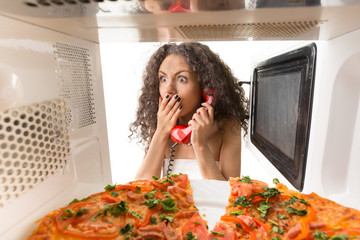 Girl cooking a pizza