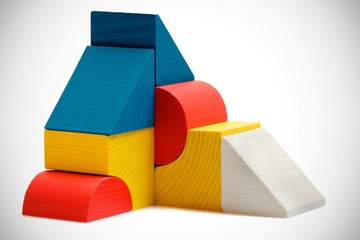 abstract composition of wooden blocks on white