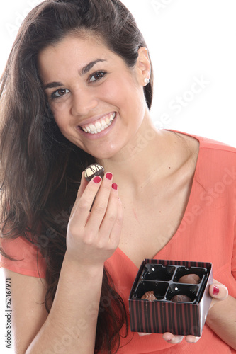 Model Released. Young Woman Holding a Box of Chocolates
