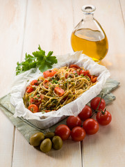 spaghetti with cherry tomatoes and green olives