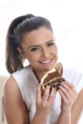 Model Released. Young Woman Eating Carrot Cake