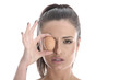 Model Released. Young Woman Holding a Brown Egg