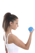 Model Released. Young Woman Exercising with Weights