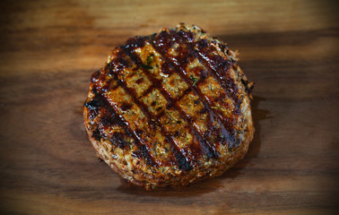 Juicy beef hamburger beef meat patty, barbecued with grill marks