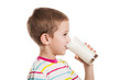 Smiling child boy drinking milk