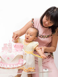 baby help mother cut cake