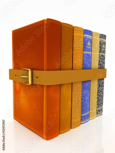 Stack of leather book with belt on white background