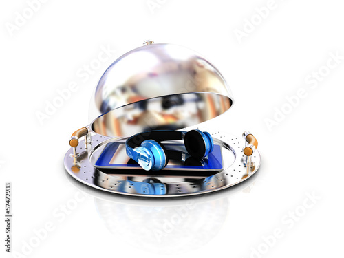 Phone and headphones on glossy salver dish under a cover