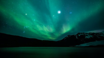 Northern lights (Aurora borealis) over the lake, Iceland