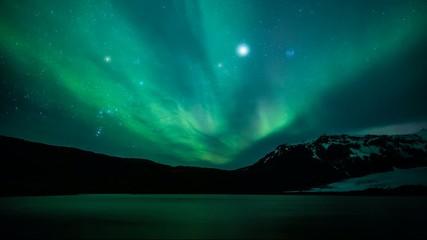 Northern lights (Aurora borealis) over the lake, Iceland