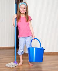 little girl washing the floor
