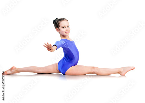 little girl sits on a splits