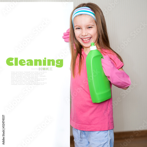 little girl cleans the house