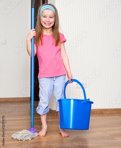 little girl washing the floor
