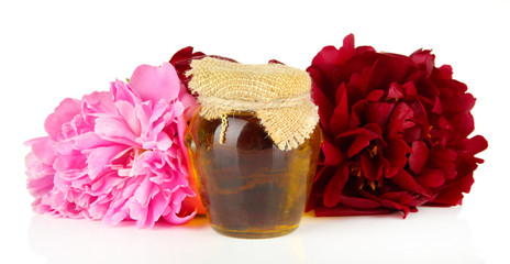 Jar of honey, honeycombs with flowers of peony, isolated