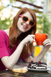 Style redhead girl with cup and cake