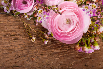 Gentle bouquet from roses on a wooden background