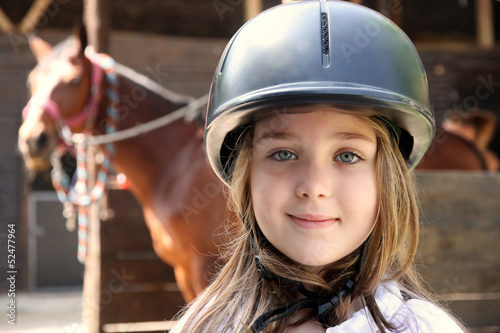 Little girl and brown Horse - 52477964
