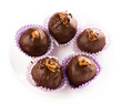 Delicious assorted dark chocolate truffle candies, top view