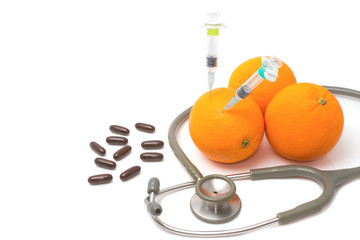 Pill,stethoscope,syringe with orange fruit ,Vitamin C supplement