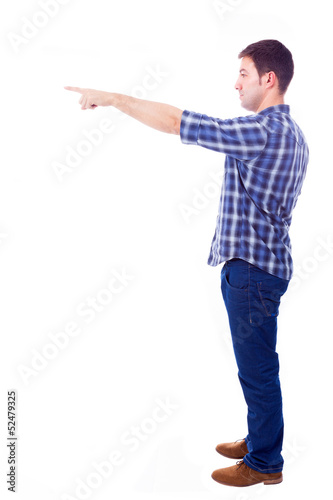 young casual man pointing towards copyspace, isolated on white b