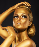 Reflexion. Woman with Bright Golden Makeup. Bronze Bodypaint