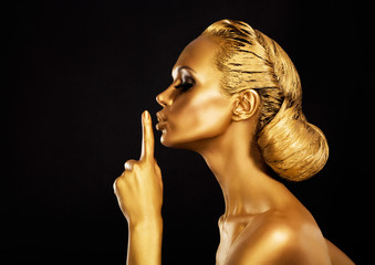 Secrecy. Bodyart. Golden Woman showing Silence Sign. Hush!