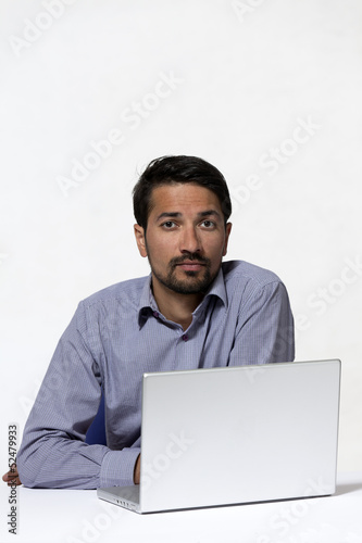 Young asian indian with laptop
