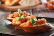 Bruschetta with mozzarella and tomato. Selective focus