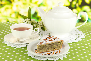 Delicious poppy seed cake with cup of tea